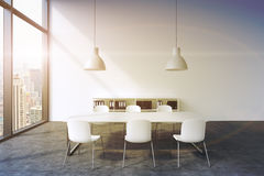 A conference room in a modern panoramic office in New York. White table, white chairs, two white ceiling lights and a bookcase. 3D Royalty Free Stock Photography