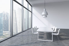 A conference room in a modern panoramic office with Singapore city view. White table, white chairs and two white ceiling lights. 3 Stock Photography