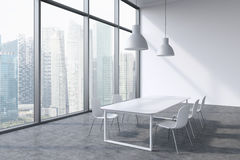 A conference room in a modern panoramic office with Singapore city view. White table, white chairs and two white ceiling lights. 3 Stock Photo