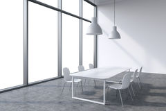 A conference room in a modern panoramic office with whit copy space in the windows. White table, white chairs and two white ceilin Royalty Free Stock Photos