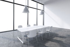 A conference room in a modern panoramic office with whit copy space in the windows. White table, white chairs and two white ceilin Royalty Free Stock Image