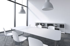 A conference room in a modern panoramic office with white copy space in windows. White table, white chairs, two white ceiling ligh Stock Image