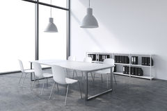 A conference room in a modern panoramic office with white copy space in windows. White table, white chairs, two white ceiling ligh Royalty Free Stock Image