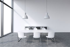 A conference room in a modern panoramic office with white copy space in windows. White table, white chairs, two white ceiling ligh Stock Photography