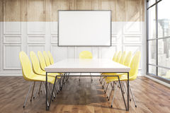 Conference room in office with poster. Conference room in office with wooden walls. Big poster above table with chairs. 3D render. Mock up Stock Images