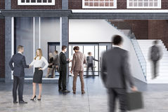 Conference room in an office with a staircase, men Royalty Free Stock Photos