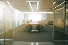 Conference room. Open glass door revealing modern conference room interior with ceiling lamps, blank whiteboard on brick wall, wooden floor and panoramic window Royalty Free Stock Photos