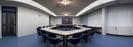 Conference room overview. A 180 degrees widangle view of an empty conference room stock photography