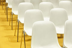 Conference room with plastic chairs detail and yellow floor Royalty Free Stock Image