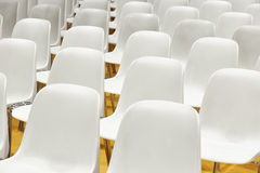 Conference room with plastic chairs detail and yellow floor. Stock Images