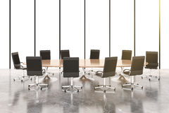 Conference room with round wooden table, chairs and concrete flo Royalty Free Stock Photo