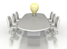 Conference room table with a large light bulb Royalty Free Stock Image