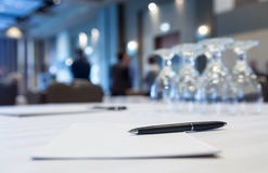 Conference room with tables with people Royalty Free Stock Photo
