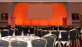 Conference room and stage. A conference room with tables and a stage set up Royalty Free Stock Photo