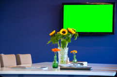 Conference room  with TV monitor. For your needs (green color on the TV can be replaced with your picture Stock Photography