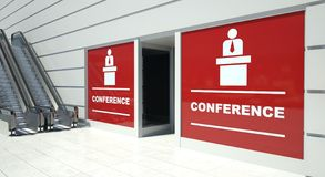 Conference on shopfront windows and escalator Royalty Free Stock Image