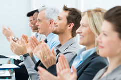 Conference success. Businesspeople In A Row Greets With Clapping Hands Royalty Free Stock Photos