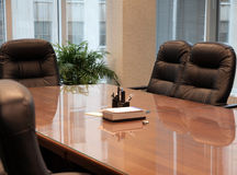 Conference Table. Clean conference table with comfortable chairs Stock Image