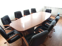 Conference Table. Table from tree and soft chair from black skin Stock Images