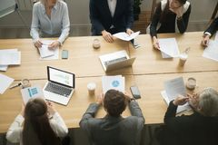 Conference table with business people group working together, te. Business young and senior people group working together sitting at conference table office desk Royalty Free Stock Photos