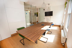 Conference table and chairs in office Stock Images