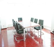 Conference table and comfortable chairs Stock Photo