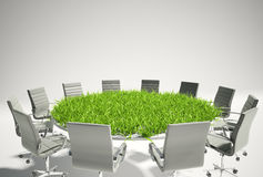 Conference table covered with grass. Business outlook concept Stock Images