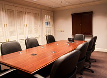 Conference Table and Louvred Windows Royalty Free Stock Photo