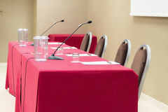 Conference table with microhones Royalty Free Stock Photography