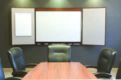 Conference Table w/Blank Whiteboard. A wooden conference table with leather chairs and a blank whiteboard Stock Photos
