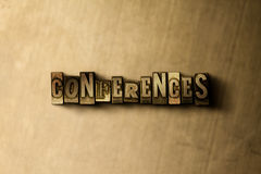 CONFERENCES - close-up of grungy vintage typeset word on metal backdrop Stock Photo