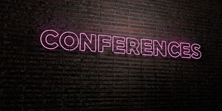 CONFERENCES -Realistic Neon Sign on Brick Wall background - 3D rendered royalty free stock image Stock Photos