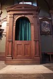 Confession booth. Antique Croatian catholic church interior. Confession booth Stock Photo