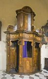 Confession booth. Baroque confession booth at a church Stock Photo