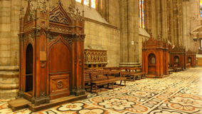 Confession booths at Duomo. Milan Stock Images