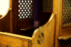 Confessional in the church Stock Images