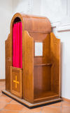 Confessional in a church Stock Photo