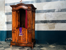 Confessional in old church Royalty Free Stock Image