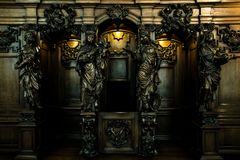 Confessional with wooden statues Royalty Free Stock Photography