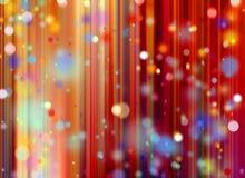 Confetes contra um fundo borrado vermelho da cortina Foto de Stock