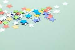 Confetes da estrela no fundo neutro Imagem de Stock Royalty Free