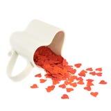 Confetes do coração que caem fora do copo Imagens de Stock Royalty Free
