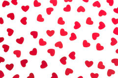 Confetes vermelhos dos corações do teste padrão decorativo do dia do ` s do Valentim isolados no fundo branco Imagens de Stock
