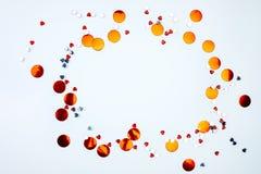 Confetes vermelhos em um fundo branco imagem de stock royalty free
