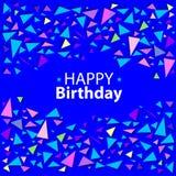 Confeti coloreado de triángulos en un fondo azul Foto de archivo