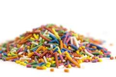 Confeti colorido del caramelo aislado en el fondo blanco foto de archivo libre de regalías