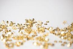 Confeti de la tachuela del oro Fotografía de archivo libre de regalías