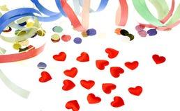 Confeti en forma de corazón rojo Fotos de archivo libres de regalías
