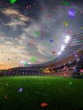 Confeti y malla de la puesta del sol del estadio con las fans de la gente 3d hacen el ejemplo nublado fotografía de archivo