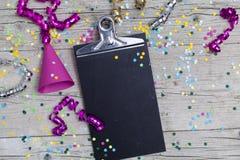 Confetti масленицы на деревянной предпосылке Стоковое Фото
